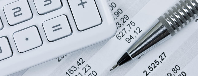 Accounting tools and services including a calculator, pen and information.